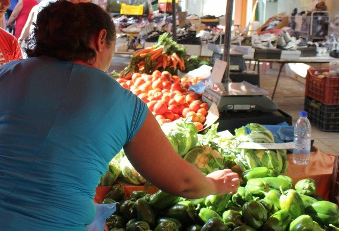 Woman at market Greece photo